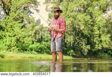 Ideas To Inspire You. Fisherman Show Fishing Technique Use Rod. Man Catching Fish. Mature Man Fly Fi