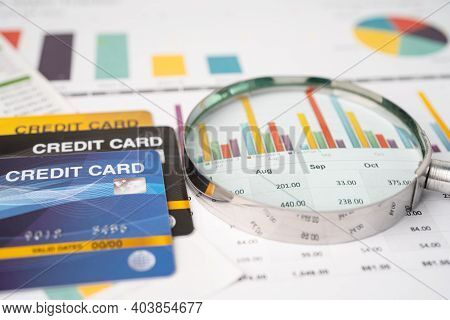 Credit Card Model With Magnifying Glass, Financial Development, Accounting, Statistics, Investment A