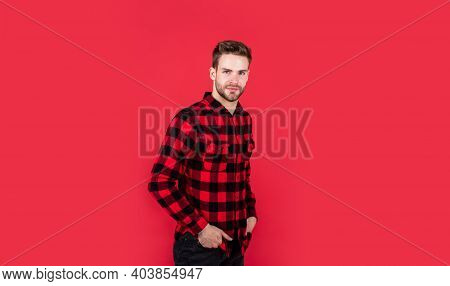 Young Handsome Man In Checkered Shirt Has Bristle On Face, Style
