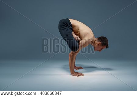 Muscular yoga keeps balanc in difficult pose