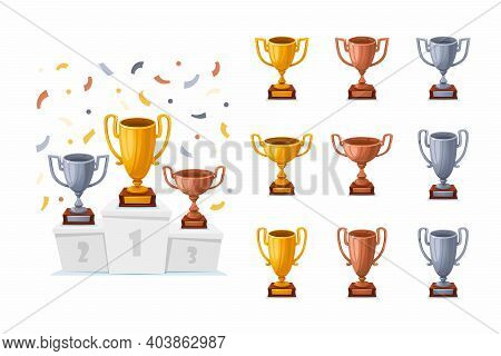 Trophy Cups On A Podium With Confetti. Gold, Silver, And Bronze Winner Prize Cups Set With Different