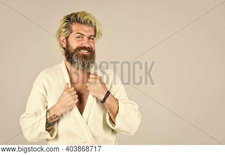 Man In Bathrobe In Bathroom. Hygiene And Spa. Spa Resort. Bearded Guy Wearing White Bathrobe. Mature