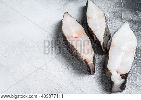Raw Fresh Steak Fish Halibut On The Stone Table. White Background. Top View. Copy Space