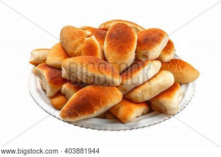 Fresh Pies On A White Plate And On A White Isolated Background.