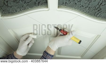 Restoration Of A White Wood Door, Master Sealing The Scratch Close-up, Furniture Restoration.