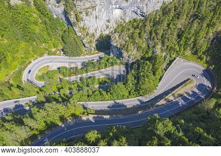 Curvy Mountain Road Viewed From Above In Romanian Carpathians. The Bicaz Gorge Is A Canyon In The No