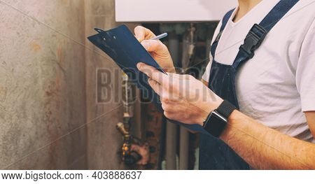 The plumber calculates the amount for the work performed