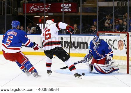 NEW YORK-APR 27: New Jersey Devils left wing Patrik Elias (26) takes a shot on New York Rangers goalie Henrik Lundqvist (30)  at Madison Square Garden on April 27, 2013 in New York City.