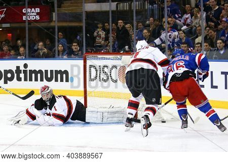 NEW YORK-APR 27: New York Rangers right wing Mats Zuccarello (36) takes a shot on New Jersey Devils goalie Johan Hedberg (1) at Madison Square Garden on April 27, 2013 in New York City.