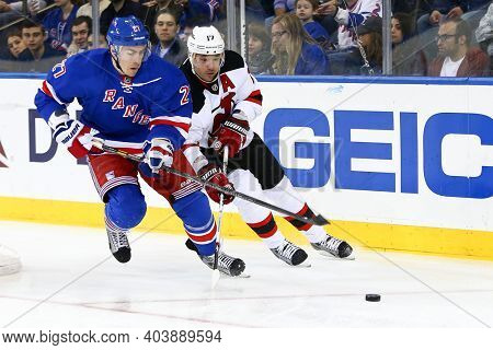 NEW YORK-APR 27: New York Rangers defenseman Ryan McDonagh (27) and New Jersey Devils right wing Ilya Kovalchuk (17) battle for the puck at Madison Square Garden on April 27, 2013 in New York City.