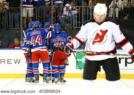 NEW YORK-APR 27: New York Rangers left wing Rick Nash (61) celebrates with teammates after scoring a goal against the New Jersey Devils at Madison Square Garden on April 27, 2013 in New York City.