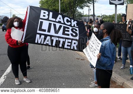 HUNTINGTON, NY - MAY 31: Peaceful protesters during a Black Lives Matter rally in response to the death of George Floyd on May 31, 2020 in Huntington, New York.