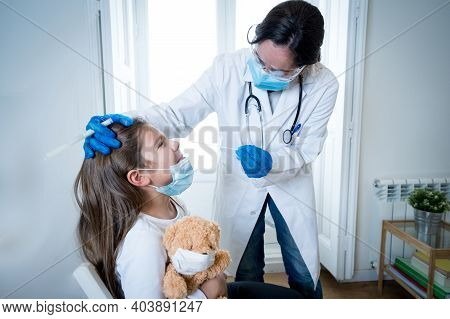 Nurse Testing Young Girl For Coronavirus Infection Taking Rapid Covid-19 Test. Doctor Performing Nas