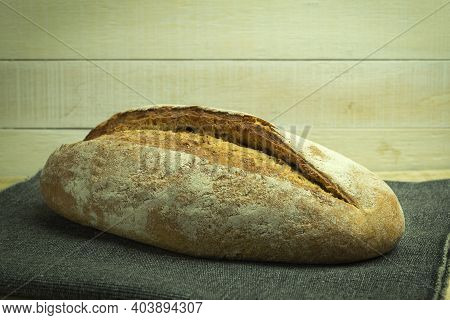 Fresh Homemade Bread Lies On Planks And Fabrics. Homemade Bread According To The Original Recipe. Cl