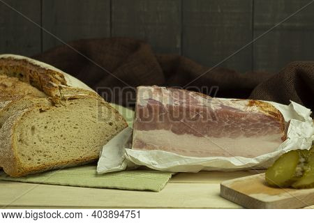 Lard With A Layer Of Meat And Bread. Pork Tenderloin Lard With Meat On A Wooden Background With Spac