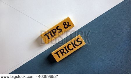 Tips And Tricks Symbol. Wooden Blocks With Words 'tips And Tricks'. Beautiful White And Blue Backgro
