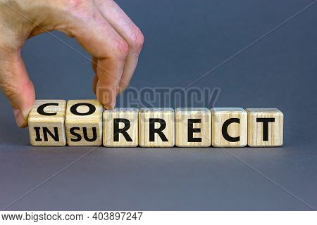 Correct Vs Insurrect Symbol. Businessman Hand Turns Wooden Cubes And Changes The Word 'insurrect' To