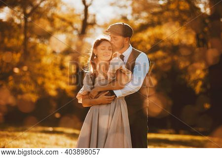 Photo Of Charming Couple Embracing During Sunset, Just Married Couple