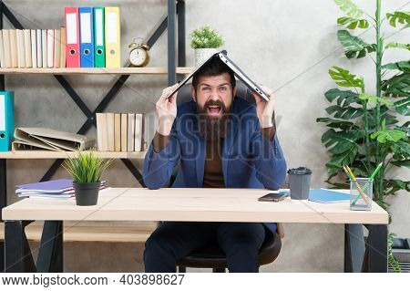 In His Own Crazy Way. Crazy Man Hold Laptop On Head. Computer Technology. Business Communication. E-