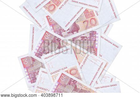 20 Croatian Kuna Bills Flying Down Isolated On White. Many Banknotes Falling With White Copy Space O