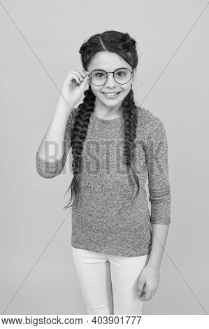Adorable Nerd. Schoolgirl Concept. Smart Girl Bad Eyesight. Let Me See. Reading Better With Eyeglass