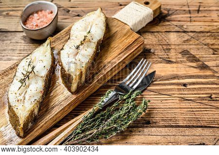 Baked Halibut Fish Steak. Wooden Background. Top View. Copy Space