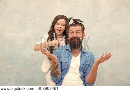Happy Childhood. Upbringing Happy Daughter. Family Leisure Concept. Girl Dad Hairdo. Daughter Playin