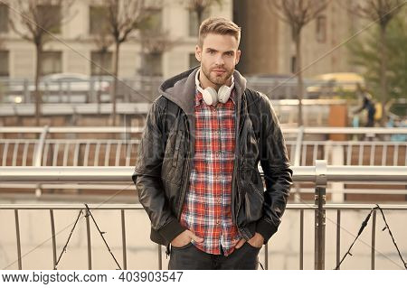 In Contemporary Style. Handsome Guy On Modern Urban Environment. Modern Man Wear Headphones Outdoor.