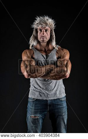 Confident Man Cross Strong Muscular Arms With Biceps Triceps Muscles In Casual Wear Black Background
