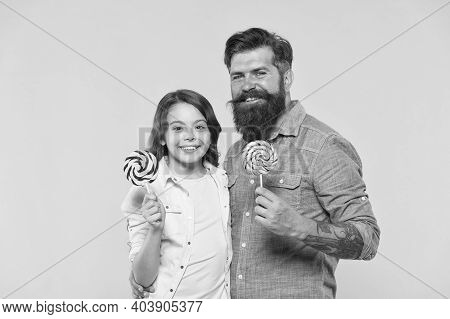 Dessert Makes Mouths Happy. Happy Family Hold Lollipops Yellow Background. Father And Daughter Enjoy
