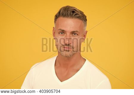 Taking Care Of Your Hair. Unshaven Guy Yellow Background. Handsome Man With Short Facial Hair. Skin