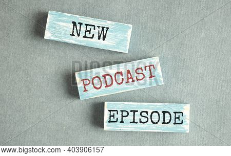 Top View Of Text New Podcast Episode On Wooden Block, Podcasting Concept.