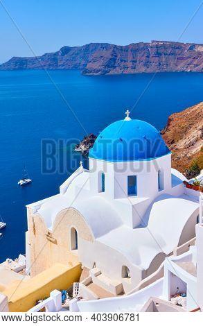 White greek church on picturesque coast of Santorini island, Oia, Greece. Greek landscape