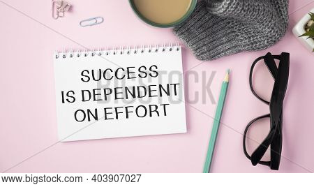Business Concept. Notebook With Text Success Is Dependent On Effort Sheet Of White Paper For Notes,