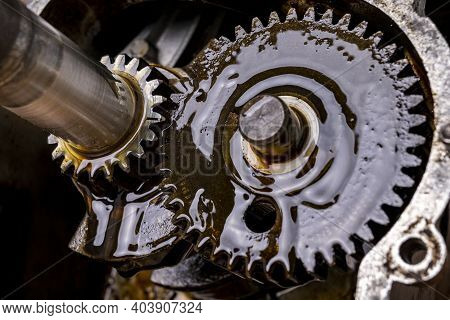 Metal Gears Working In An Internal Combustion Engine. Torque Transmission Gear.