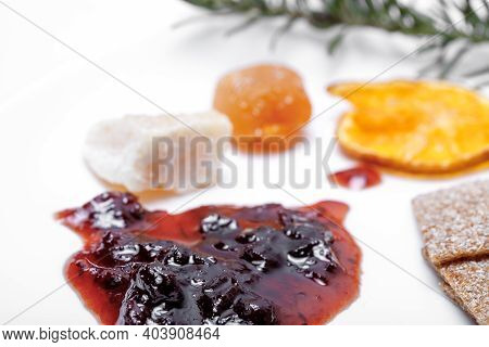 Blot Of Berry Jam Isolated On White And On A Background Of Unsharp Fruits And Cheese