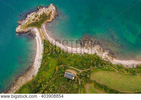 Aerial top view of Trinity point and chapel in Brittany, France