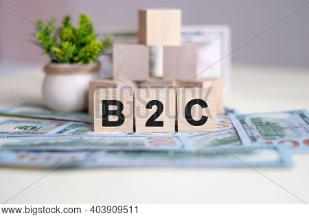 Dollars Banknote With Calculator And Word B2c. Banknotes And Wooden Cubes With Letters. Tax Concept