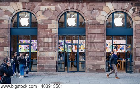Strasbourg, France - Feb 14, 2019: Busy Place Kleber With A Facade Of Apple Store Computers Smartpho