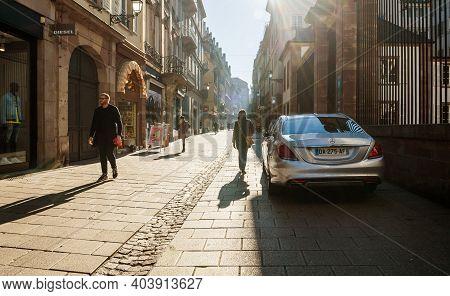 Strasbourg, France - Feb 16, 2019: Pedestrian Street With Few People Walking Near Luxury Mercedes-be