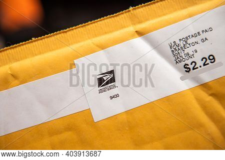 Paris, France - Feb 21, 2019: Close-up Macro Shot Of Yellow Envelope With Logotype Insignia Of Unite