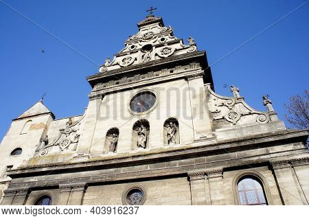 Catholic Church. The Upper Part Of The Facade Of The Catholic Church. Medieval Architecture. Sculptu
