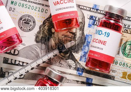 Vaccine Vials And Syringe Lying On The Money. Purchase Or Trading Vaccine Concept. Vaccination Again