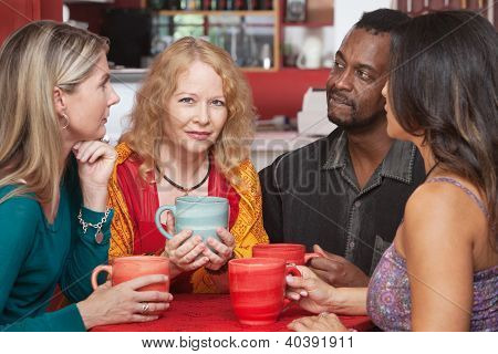 Mature European woman with sympathetic friends in coffeehouse poster