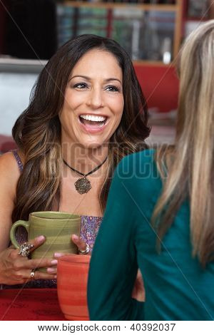 Mature Woman In Cafe Laughing
