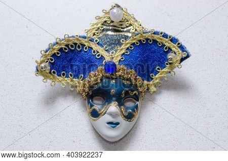 Blue And Golden Carnival Mask Souvenir On Light Background. Traditional Venetian Festival Gift.