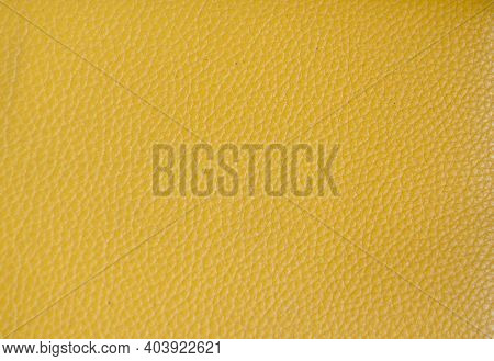 Yellow Synthetic Leather Texture Background. Pattern Of Yellow Fake Leather For Fashion And Decor.