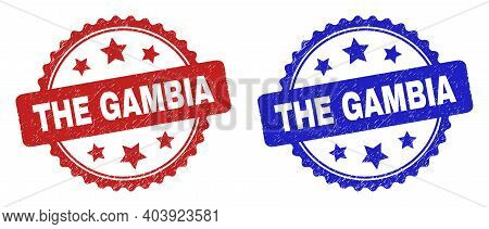 Rosette The Gambia Stamps. Flat Vector Distress Stamps With The Gambia Text Inside Rosette Shape Wit