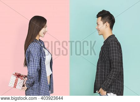 Young Woman Giving Present To Boyfriend Background