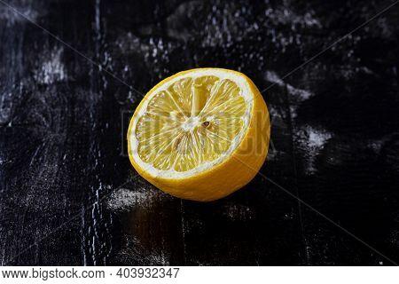 Fresh Ripe Lemons On Dark Stone Background/ Half Ripe Lemon On A Black Background. Lemon Cutaway. Vi